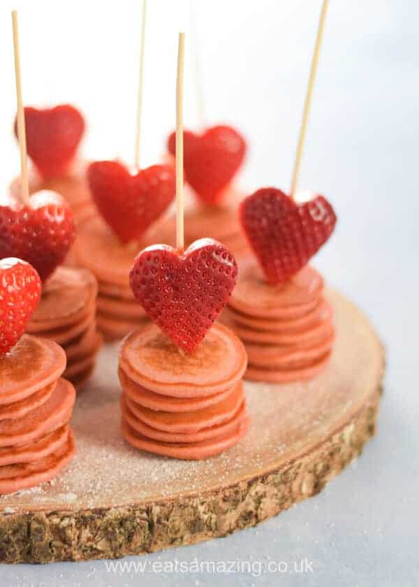 Fun strawberry heart topped mini pancake stackers - perfect for a cute Valentines Day breakfast for kids - Eats Amazing UK