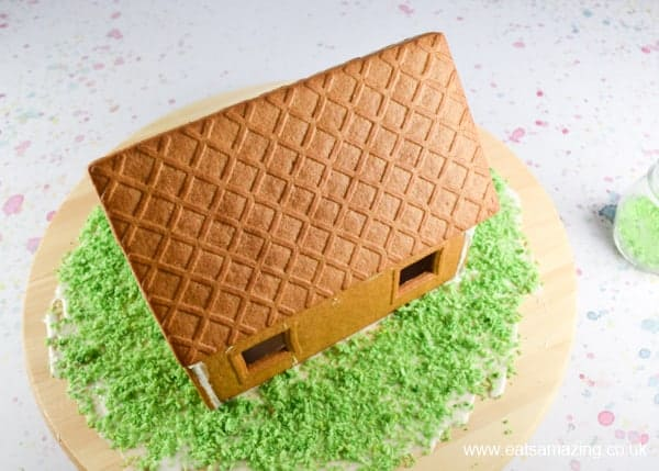 How to make an Easter gingerbread house - Step 2 add green coconut grass
