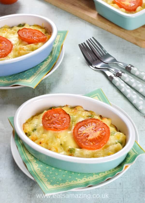 Individual portions of homemade macaroni cheese with peas and sweetcorn - add extra vegetables to a classic family recipe for a healthier meal the kids will love