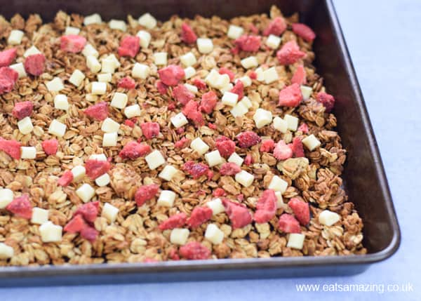 Easy strawberries and cream granola recipe - step 4 finish with freeze dried strawberry pieces