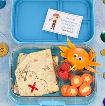Fun and healthy Pirate themed bento box lunch for kids with edible treasure map quesadillas orange octopus and carrot coins
