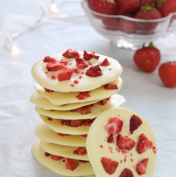 Gorgeous strawberries and cream white chocolate mendiants - these giant chocolate buttons are great quick and easy gifts for kids to make