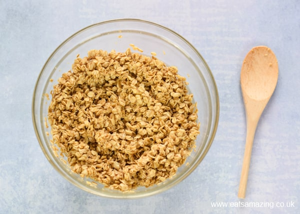 How to make easy homemade granola - step 1 mix together the oats oil and honey