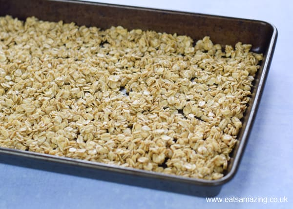How to make easy homemade granola - step 2 spread over a baking tray and bake in the oven until golden