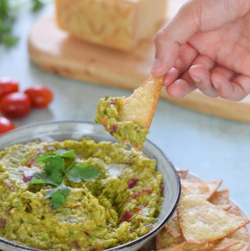 Easy homemade kid-friendly guacamole recipe with Grana Padano baked tortilla crisps - fun healthy recipes for kids to cook