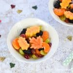 Fun and healthy autumn fruit salad recipe with maple lemon dressing and fruity autumn leaves