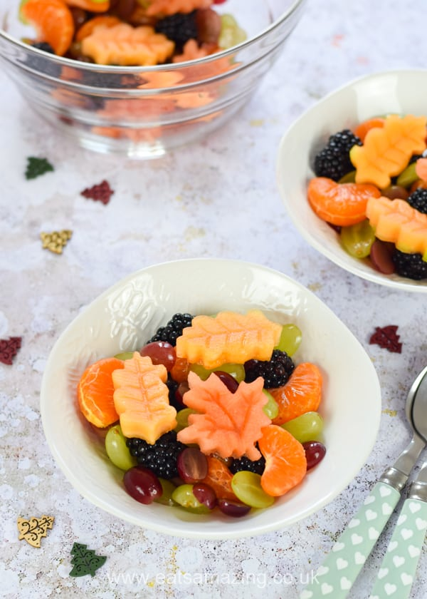 Pretty autumn fruit salad with edible autumn leaves - healthy fun food for kids