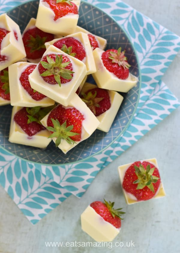 These gorgeous white chocolate covered strawberry ice cubes are really easy to make and perfect for summer party food