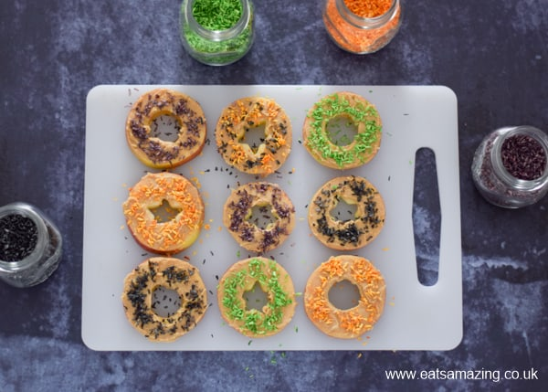 Fun and healthy Halloween food for kids - monster apple donuts recipe - step 4 sprinkle with homemade Halloween coconut sprinkles
