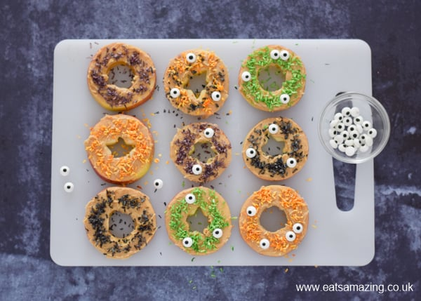 Fun and healthy Halloween food for kids - monster apple donuts recipe - step 5 finish with edible candy eyes