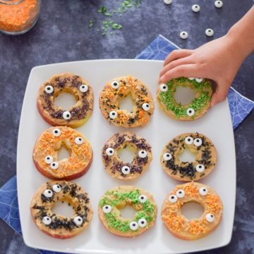 Fun monster apple donuts - healthy Halloween snack recipe for kids with homemade coconut sprinkles