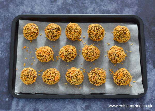 How to make pumpkin shaped pumpkin spice energy bites - step 3 place on a lined tray or plate