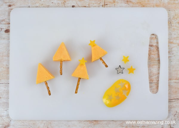 How to make a simple cheese Christmas trees snack - step 3 add yellow pepper stars