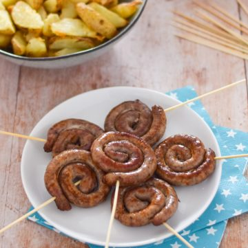 How to make your own Cumberland Sausage Swirls - serve on a stick for fun Firework themed food for New Years Eve and Bonfire Night