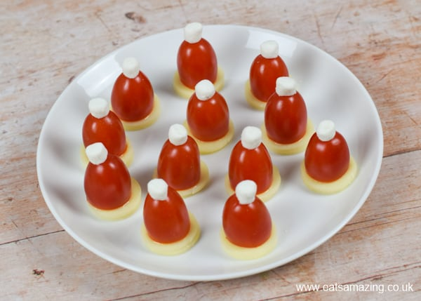 Quick and easy edible tomato Santa hats recipe - fun and healthy Christmas party food idea for kids