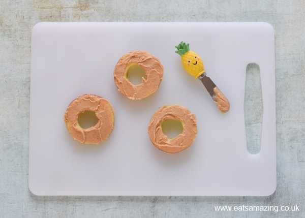 How to make raw apple donuts - fun snack for kids - step 3 spread with peanut butter