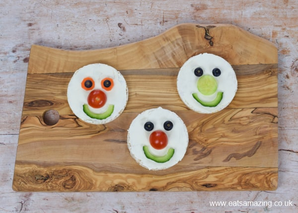 Fun food tutorial - how to make cute rice cake fairy faces for kids - step 2 add vegetables and blueberries to make fun faces