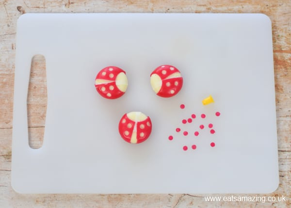 How to make a Babybel cheese ladybug - step 3 use a tiny circle cutter to cut spots from the wax