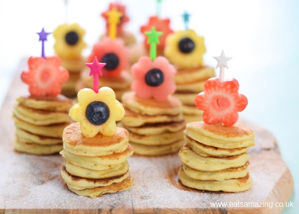 Cute mini pancake stacks with fruit flowers - fun special breakfast idea for kids