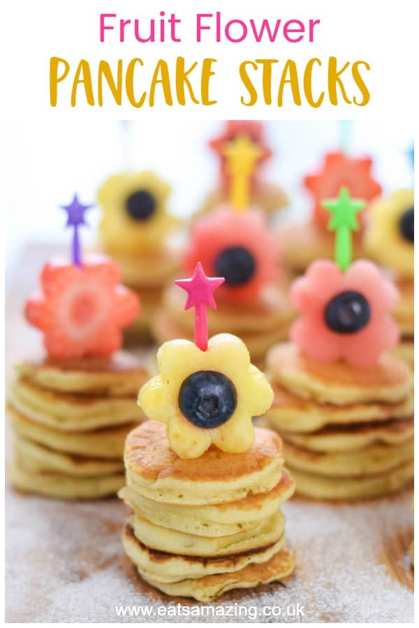 Fruit Flower Mini Pancake Stacks recipe - this fun spring breakfast is perfect for Mothers Day or Easter with kids #EatsAmazing #pancakes #kidsfood #funfood #foodart #breakfastrecipes #mothersday #easter #flowers #easyrecipe #cutefood