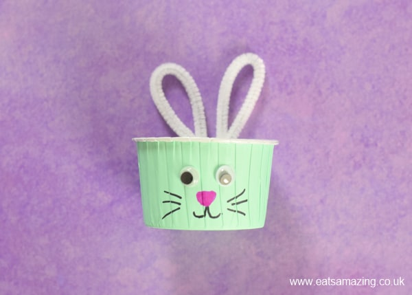 How to make easy Easter Bunny Snack Cups fun food tutorial for kids - setp 5 add ears to the cup before filling with snacks