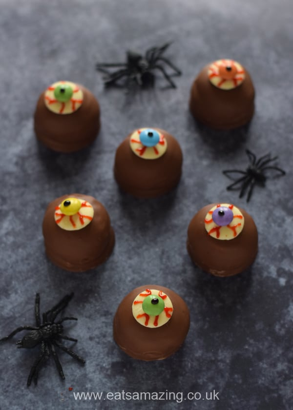 6 eyeball teacakes with plastic spiders - fun Halloween party food idea