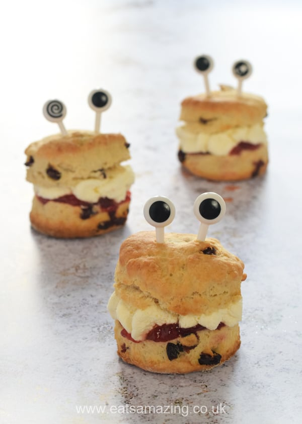 3 Monster Scones with jam, whipped cream and googly eye food picks