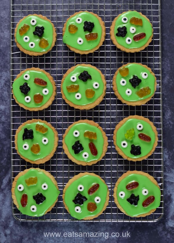 Swamp monster theme Halloween cookies setting on a cooling rack