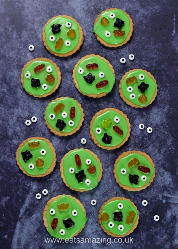 Swamp monster cookies and candy eyeballs on a dark Halloween backdrop
