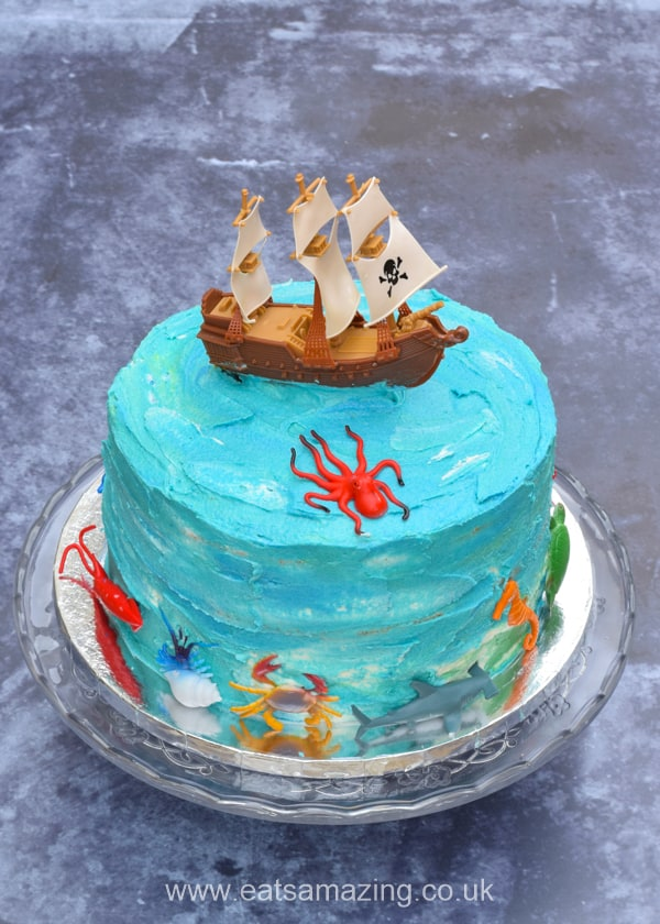Easy ocean themed pirate ship cake recipe with pirate cake topper and ocean animals