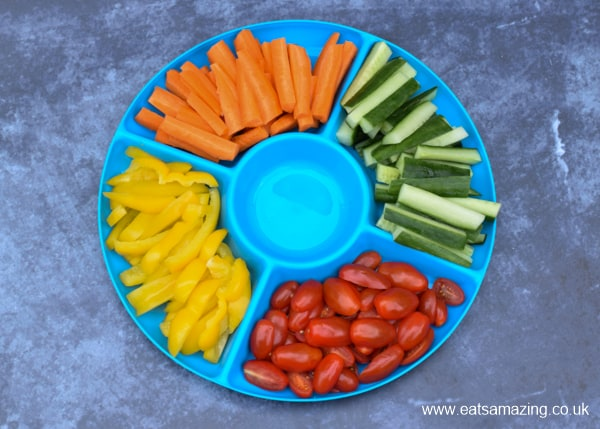 Blue platter with a rainbow of mixed vegetable sticks