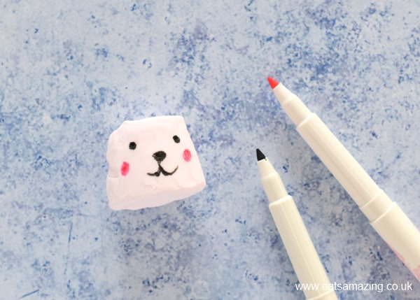 How to make bunny marshmallows - step 1 draw on a face with edible marker pens