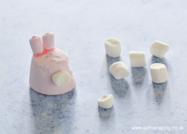 How to make bunny marshmallows - step 5 glue on the marshmallow tail with writing icing