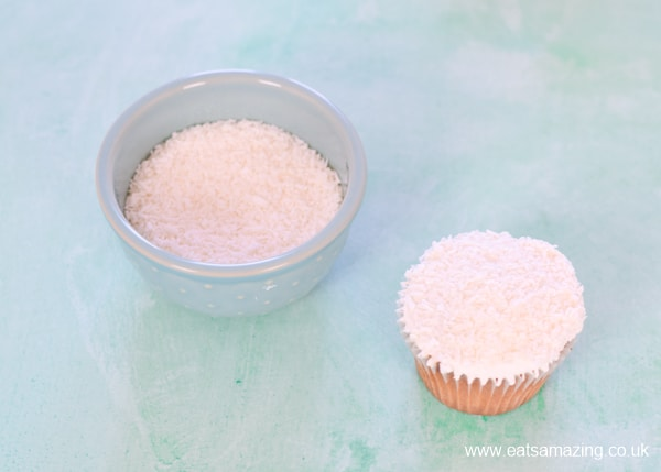 How to make lamb cupcakes - step 2 - dip iced cake into desiccated coconut