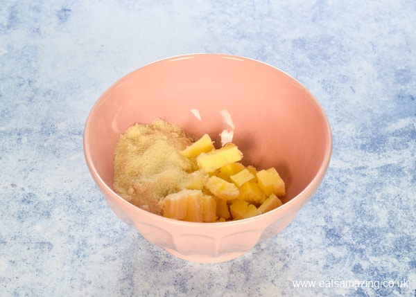 butter and sugar in a pink mixing bowl ready to be whisked