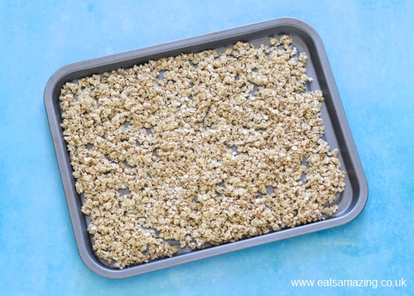 How to make easy homemade granola - step 3 spread evenly over a baking tray