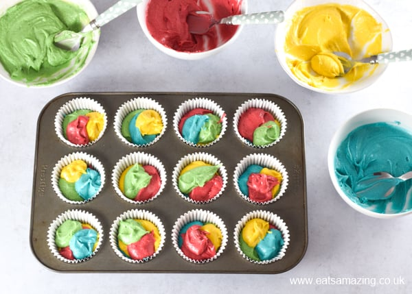 How to make easy rainbow cupcakes - step 2 divide cake mixture between muffin cups