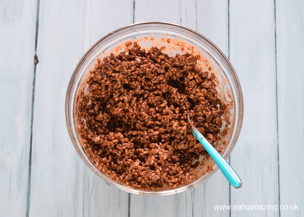 How to make rice crispy nest cakes - step 3 mix in the rice crispy cereal until coated in the chocolate mixture