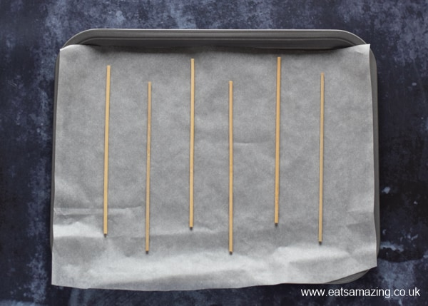How to make easy chocolate monster pops for Halloween - step 1 line a tray and place bamboo skewers on top