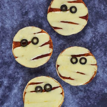 Cute and easy Mini Muffin Pizzas recipe - fun Halloween party food for kids