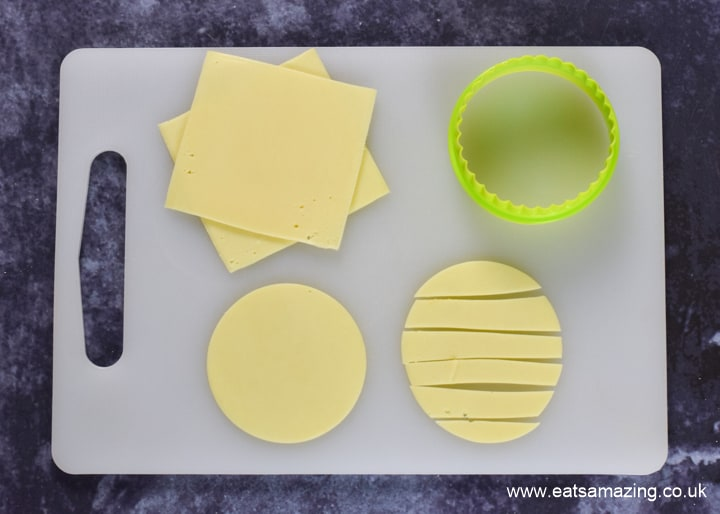 How to make Halloween Mummy Pizzas - step 3 cut circles from cheese and slice into strips