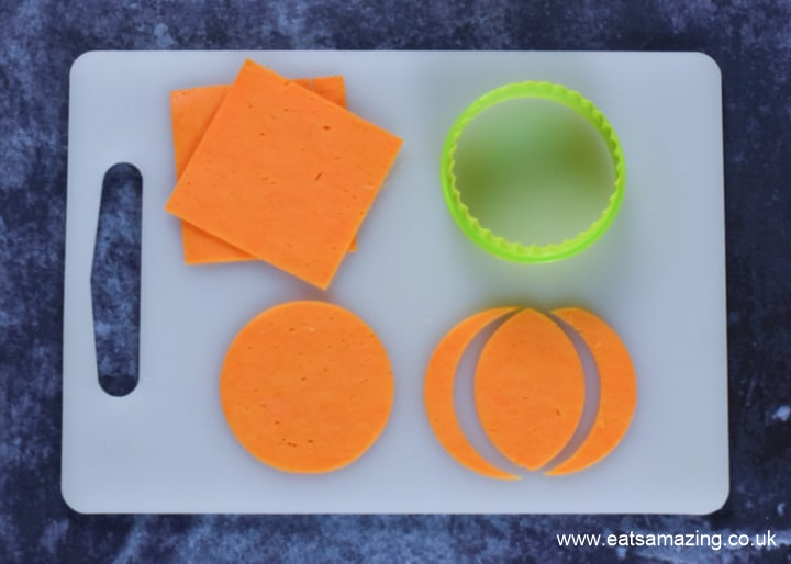 How to make Halloween Pumpkin Pizzas - step 3 cut circles from red Leicester cheese