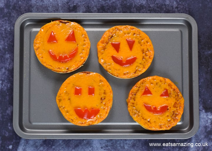 How to make Halloween Pumpkin Pizzas - step 7 bake until cheese is beginning to bubble