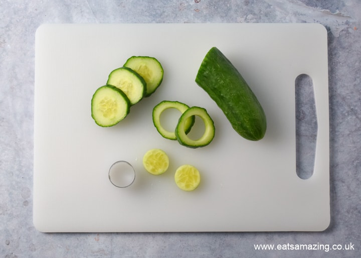 How to make mozzarella snowman snacks - step 1 cut circles from cucumber for the bases