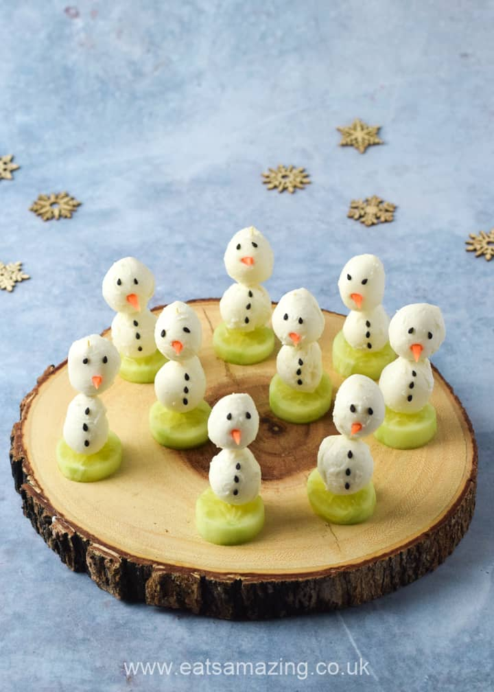 Quick and easy mozzarella snowman appetiser recipe - fun and healthy Christmas party food for kids