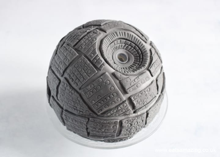 How to make a Star Wars Death Star Cake - Step 11 cover whole cake in fondant rectangles