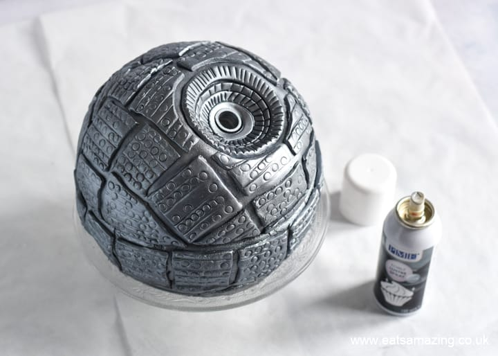 How to make a Star Wars Death Star Cake - Step 12 spray with silver edible lustre