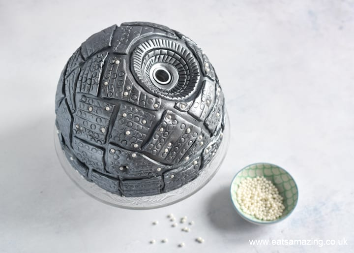 How to make a Star Wars Death Star Cake - Step 13 add sugar pearl lights