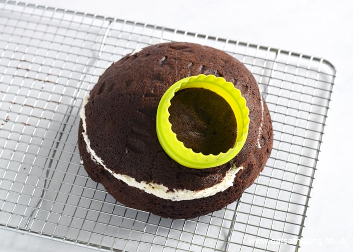How to make a Star Wars Death Star Cake - Step 2 split and fill cakes then use a circle cutter to remove a round piece from the top
