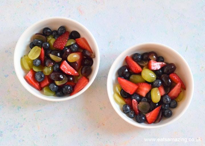 Cute and easy Easter Fruit Salad - step 4 divide fruit between bowls